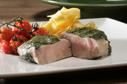 Slow-cooked veal ribeye wrapped with basil and Cabrales cheese, with pappardelle and tomatoes