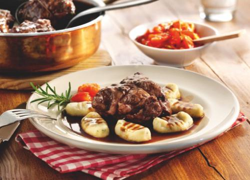 Braised veal cheeks on gnocchi and tomato