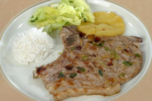 Marinated and grilled veal cutlets with pineapple